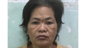 """""""Nữ quái"""" Tăng Thị Hương tại cơ quan công an. Ảnh: CHÍ THẠCH"""