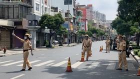 Công an quận 3, đảm bảo giao thông thông thoáng trên các tuyến đường trên địa bàn. Ảnh: CHÍ THẠCH