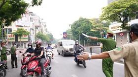 Hà Nội triển khai 6 tổ công tác xử lý nghiêm người ra đường không lý do
