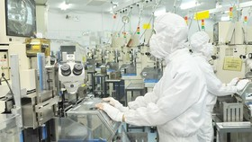 Applying high technologies in the manufacturing process in Mtex Co., sited in Tan Thuan Industrial Park of HCMC. (Photo: SGGP)