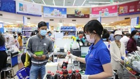 Many supermarkets in HCMC are in need of essential goods to serve the high demand of residents in the city during the social distance time. (Photo: Co.opmart Fanpage)