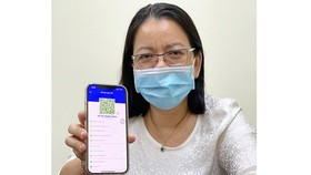 Deputy Director of the HCMC Department of Information and Communication Vo Thi Trung Trinh with her individual QR code on 'Y te HCM' app.