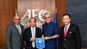 Ông Lê Khánh Hải trong lần tiếp đón lãnh đạo AFC