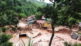 Lũ quét tràn vào huyện Nậm Pồ (Điện Biên) ngày 17-8, cuốn trôi nhiều nhà cửa, lớp học. Ảnh: NGỌC HÀ
