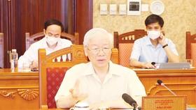 Tổng Bí thư Nguyễn Phú Trọng chủ trì họp lãnh đạo chủ chốt nghe báo cáo tình hình dịch bệnh và công tác triển khai các biện pháp phòng chống dịch Covid-19. Ảnh: TTXVN