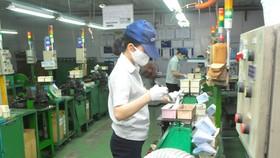 Sản xuất tại Công ty Kim May Organ, KCX Tân Thuận, quận 7. Ảnh: CAO THĂNG