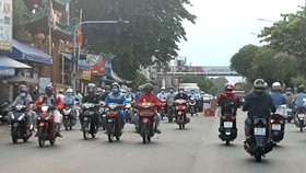 Xe gắn máy lưu thông lâu ngày cần được kiểm định khí thải  (Ảnh chụp tại TPHCM trước đợt giãn cách xã hội lần thứ 4)