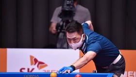 Cơ thủ Mã Minh Cẩm đeo khẩu trang khi thi đấu giải tại Hàn Quốc
