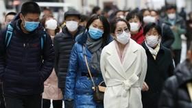 Người dân Nhật Bản đeo khẩu trang phòng chống bệnh Covid-19 trên đường phố Tokyo hôm 22-1. Ảnh: Kyodo News
