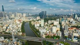 Bộ trưởng Bộ Xây dựng đề nghị thành phố làm rõ hơn sự cần thiết phải điều chỉnh quy hoạch chung theo 4 nhóm vấn đề. Ảnh: Hải An