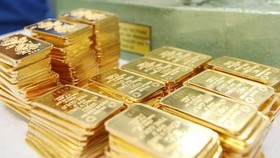 Stocks up, gold down