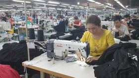 Garment, textile enterprises long for solutions to solve difficulties