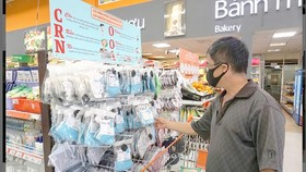 Antimicrobial face masks are sold at an outlet of Saigon Co.op. (Photo: SGGP)