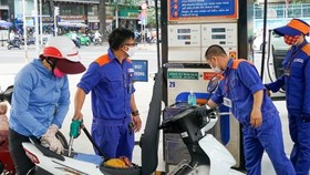 Petrol prices slightly slide after nine straight increases
