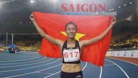 Lê Tú Chinh đoạt HC Vàng ở cự ly 200m. Ảnh: DŨNG PHƯƠNG