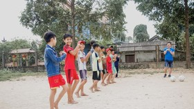 Children in Hue warm-up for football training. Photo Blue Dragon