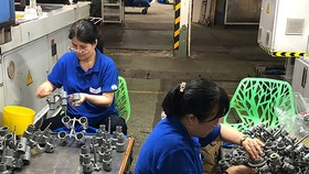 Employees are working in Binh Minh Plastics Joint Stock Company.