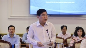 Nguyen Thanh Phong, chairman of the HCM City People's Committee, speaks at a conference reviving the city's economy last week. (Photo courtesy of the HCM City Press Centre)