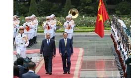 Japanese Prime Minister Yoshihide Suga gets a red carpet welcome.