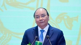 PM Nguyen Xuan Phuc speaks at the conference (Photo: VNA)