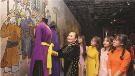 Young people visit Ao Dai Museum in  HCMC. (Photo: SGGP)