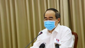 Head of the HCMC Delegation of National Assembly Deputies Nguyen Thien Nhan speaks at the meeting. (Photo:SGGP)