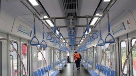 Inside a passenger train on HCM City's first metro line. The opening of the line will be delayed until 2022 (Photo: VNA)