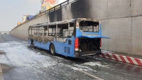 Bus catches fire.