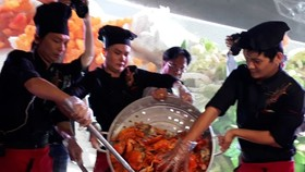 A giant pan of crab with tamarind sauce at a food festival in Ca Mau Province