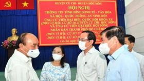 State President Nguyen Xuan Phuc with participants at the conference (Photo: SGGP)