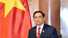 Prime Minister Pham Minh Chinh affirms that the Government is willing to devote itself to serving the Fatherland and the people. (Photo: SGGP)