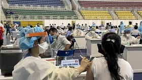 Residents at a vaccination site in HCM City. (Source: VNA)