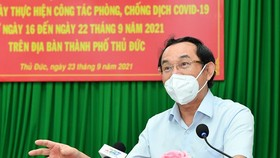 Secretary of the HCMC Party Committee Nguyen Van Nen (L) and Chairwoman of the municipal People's Council Nguyen Thi Le (R) attend working sessions with Thu Duc City and Cu Chi District respectively to review the localities' implementation of the social d
