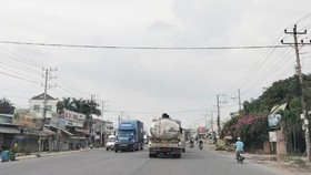 Many container trucks run on DT743 road (Photo: SGGP)