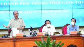 State President Nguyen Xuan Phuc speaks at the meeting. (Photo: SGGP)