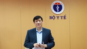 Minister of Health Nguyen Thanh Long  speaks at the conference.