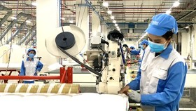 Workers of Nitori Company in Ba Ria-Vung Tau Province are working in the new normal state. (Photo: SGGP)