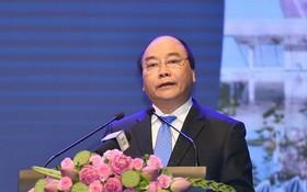 政府總理阮春福在會議上發表講話。(資料圖來源:VGP/光孝)