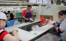 越南Vennus鞋類有限責任公司逾6000名工人昨(4)日上午重返工作崗位。(圖源:清華)
