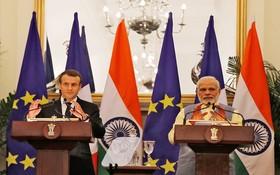 印度總理莫迪(右)和法國總統馬克龍共同出席簽約儀式。(圖源:路透社)