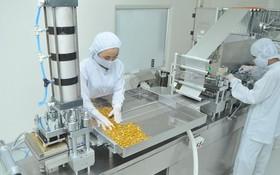 某企業生產平抑物價的藥品。
