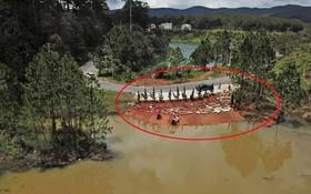 圖中畫紅圈的是已被拆除的違章工程。(圖源:段堅)