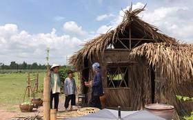 「龍騰駕霧」故事片的農村 景色之一幕。