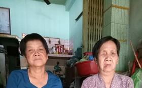 湯女(右)和妹妹都患有多種病。