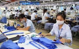 我國創造條件讓企業加強生產活動。(圖源:VNA)
