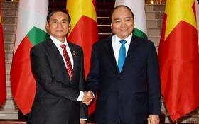 政府總理阮春福(右)與緬甸總統吳溫敏。(圖源:陳海)