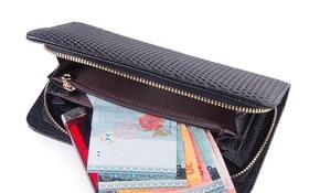 研究顯示,錢包中錢越多,人們越可能拾金不昧。(示意圖源:互聯網)