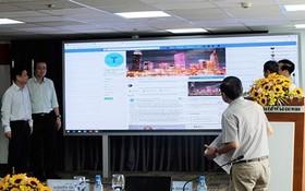 市新聞與傳播廳向與會者及媒體介紹臉書上的市基層資訊粉絲專頁。(圖源:秋紅)