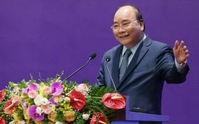 政府總理阮春福在會上致詞。(圖源:芳陲)