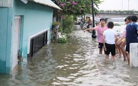 昨(29)日下午,平盛郡清多區西貢河畔一片汪洋。(圖源:嘉明)